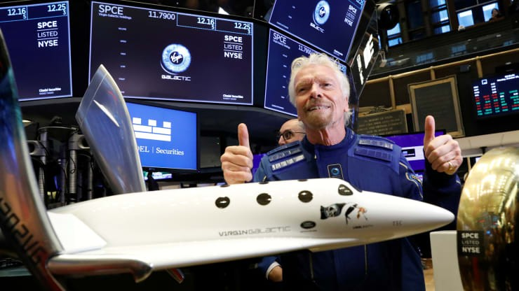 Virgin Galactic shares debut as the space tourism company begins trading under the ticker SPCE