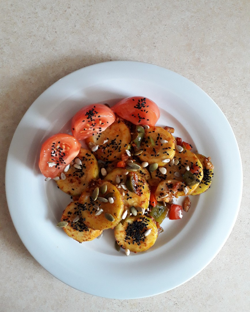 Grilled zucchini with peppers and tomatoes